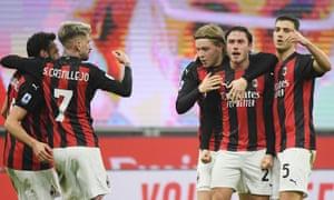 Milan's Davide Calabria celebrates scoring their first goal with team mates.