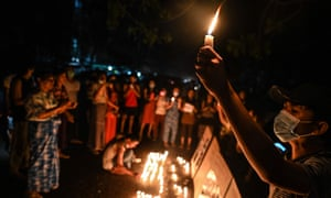 Protesters hold a ceremony to pray for those who died during demonstrations in Yangon