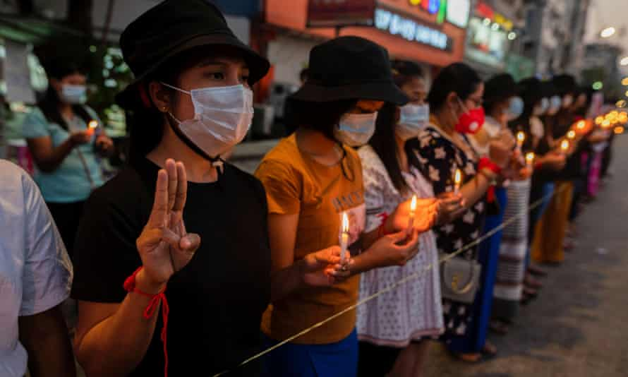 Demonstrators light candles during a protest against the military coup in Yangon, Myanmar, on Tuesday.