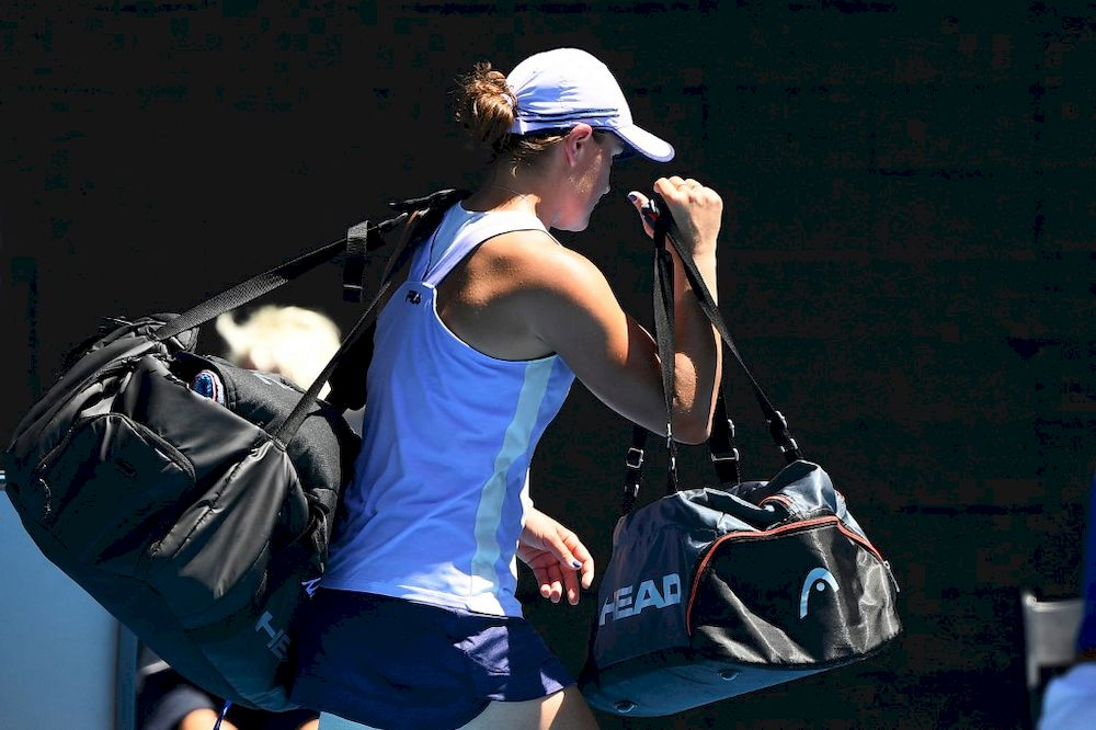 Australia's Ashleigh Barty leaves after losing against Czech Republic's Karolina Muchova during their women's singles quarter-final match at the Australian Open in Melbourne, February 17, 2021. — AFP pic
