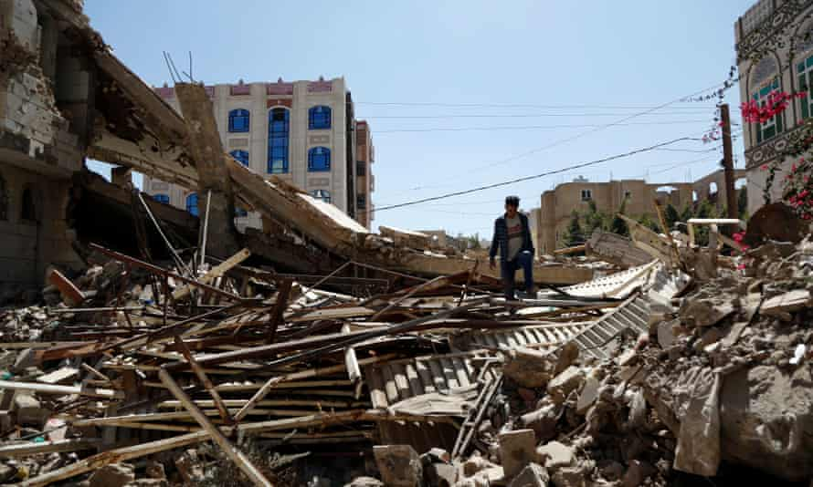 A Yemeni man inspects a house that was destroyed in an airstrike carried out during the war by the Saudi-led coalition's warplanes, on 5 February 2021 in Sana'a.
