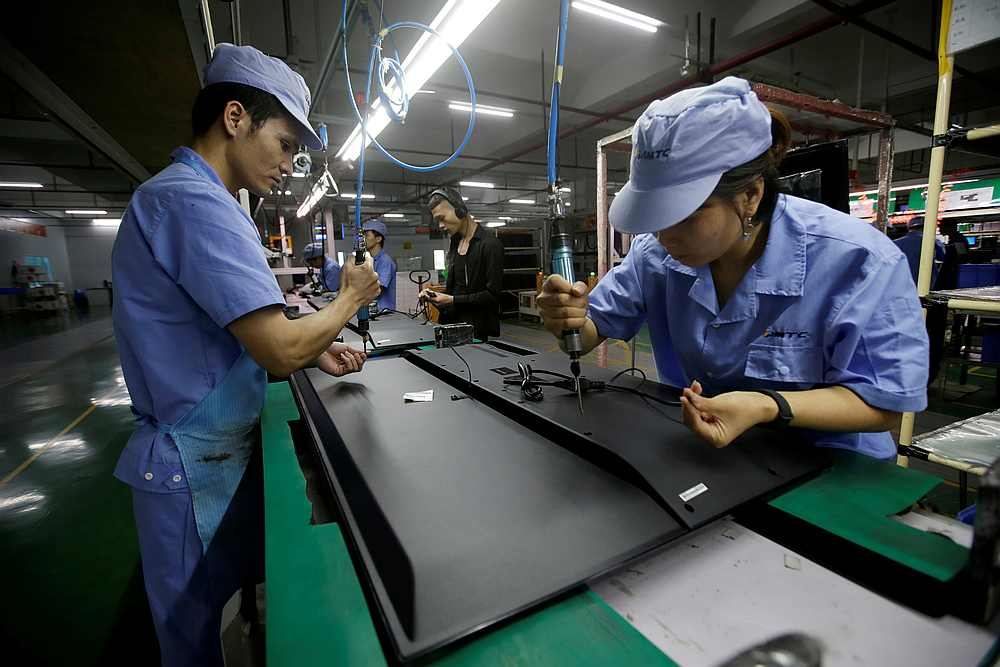 China's factory activity expanded in February at a slower pace than a month earlier, hitting the lowest level since last May. — Reuters pic