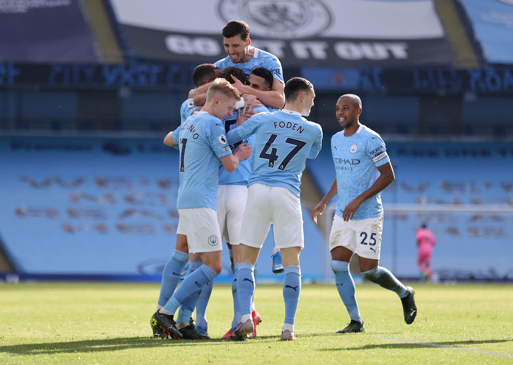 Manchester City's John Stones celebrates scoring their second goal with teammates during the match against West Ham United at the Etihad Stadium in Manchester, February 27, 2021. .— Reuters pic