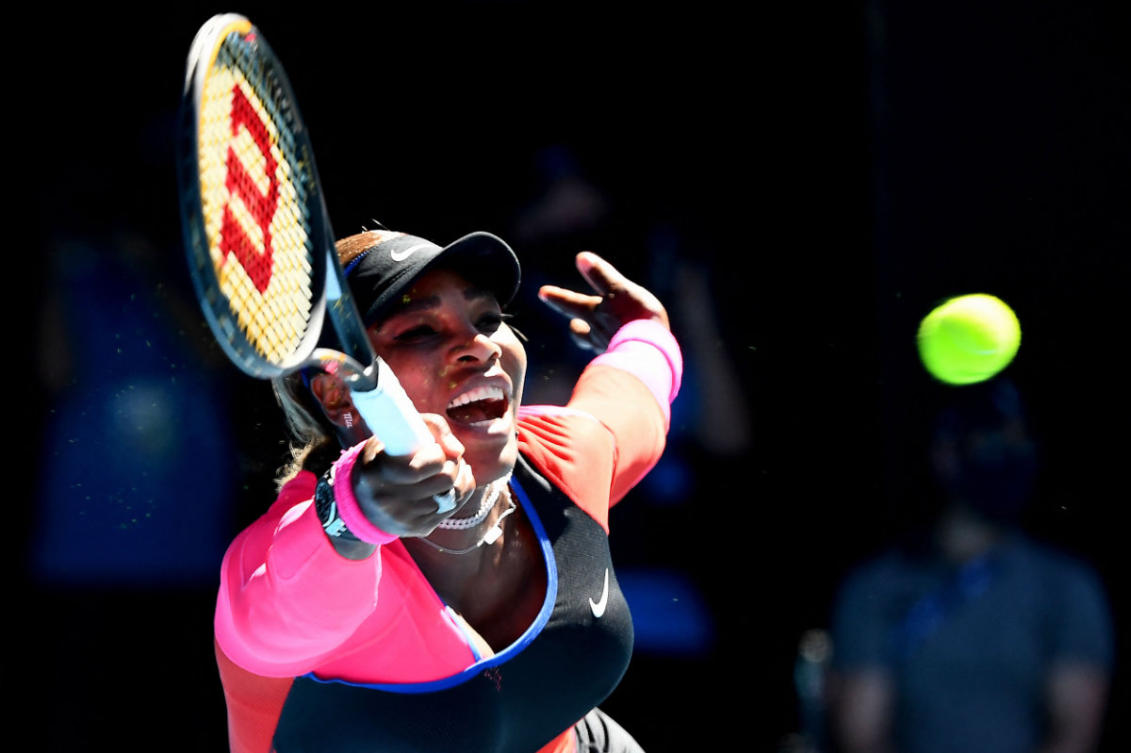 Serena Williams hits a return against Naomi Osaka during their women's singles semi-final match on day eleven of the Australian Open tennis tournament in Melbourne on February 18, 2021. (AFP / William West)