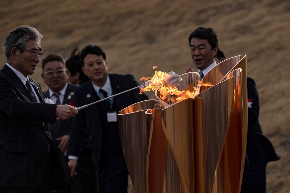 The Tokyo 2020 Olympic flame is displayed at Ishinomaki Minamihama Tsunami Recovery Memorial Park in Ishinomaki, Miyagi prefecture on March 20, 2020, after its arrival from Greece. — AFP pic