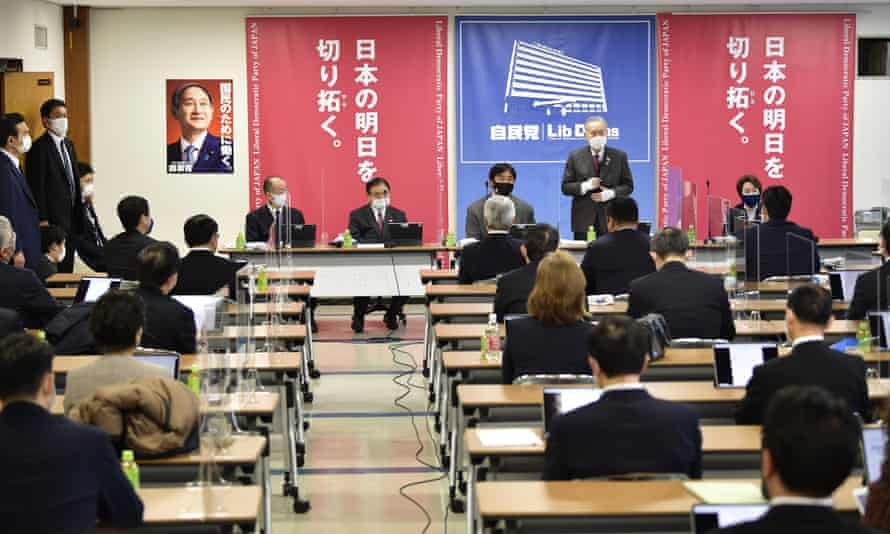 Yoshiro Mori delivering a speech on the Olympics to a mainly male audience at the Liberal Democratic Party headquarters in Tokyo.
