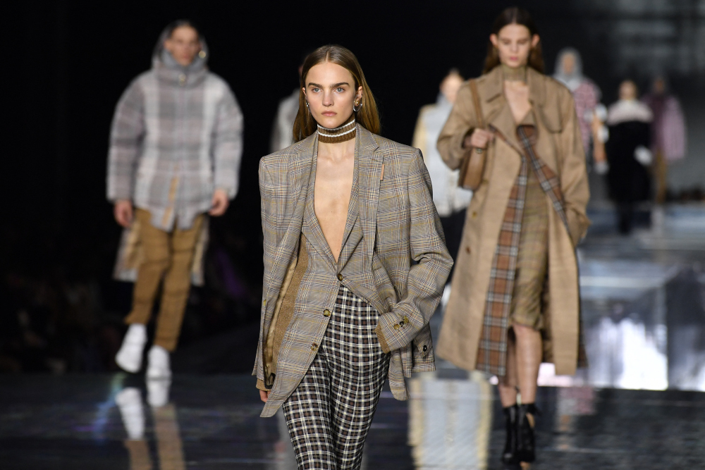 In this file photo taken February 17, 2020 models present creations during the British fashion house Burberry 2020 Autumn/Winter collection catwalk show during London Fashion Week. — AFP pic