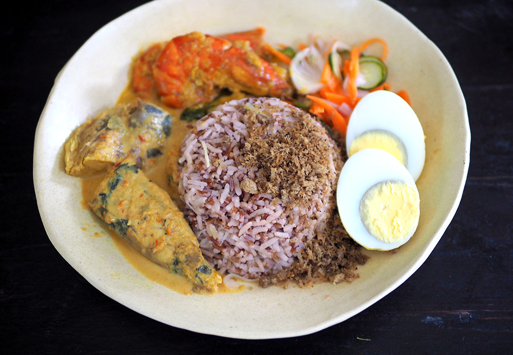 Merechik's 'nasi dagang' is gorgeous with the 'gulai ikan tongkol' made with softer, sweeter tasting 'ikan tongkol hitam', 'gulai udang' with fresh, firm prawns, 'acar' and a hard boiled egg. — Pictures by Lee Khang Yi