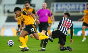 Wolves' Adama Traore goes past Joe Willock of Newcastle United.