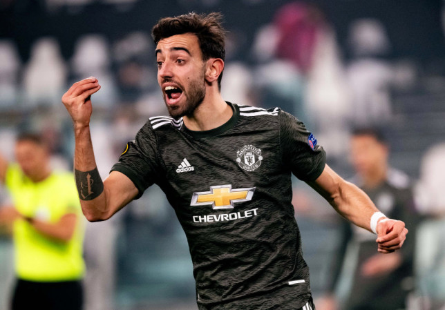 Bruno Fernandes of Manchester United celebrates scoring a goal to make the score 0-2 during the UEFA Europa League Round of 32 match between Real Sociedad and Manchester United at Allianz Stadium on February 18, 2021 in Turin, Italy.