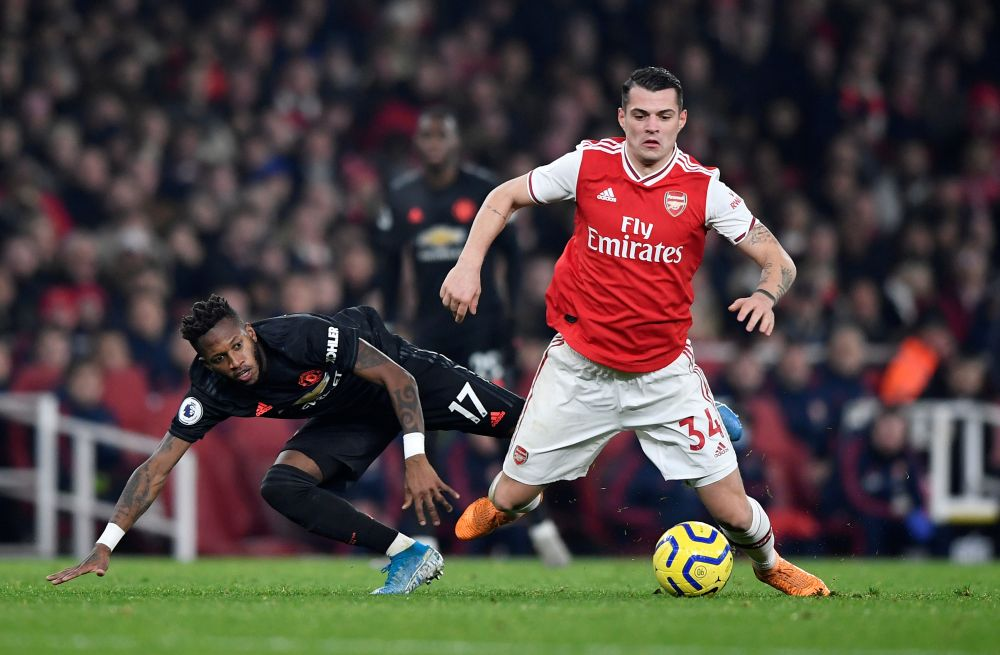Manchester United's Fred (left) in action with Arsenal's Granit Xhaka at the Emirates Stadium December 26, 2019. — Reuters pic
