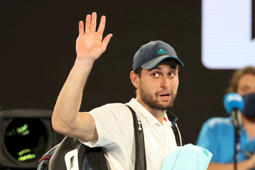Russia's Aslan Karatsev leaves the court after losing to Serbia's Novak Djokovic at the end of their men's singles semi-final match on day eleven of the Australian Open in Melbourne on February 18, 2021. — AFP pic