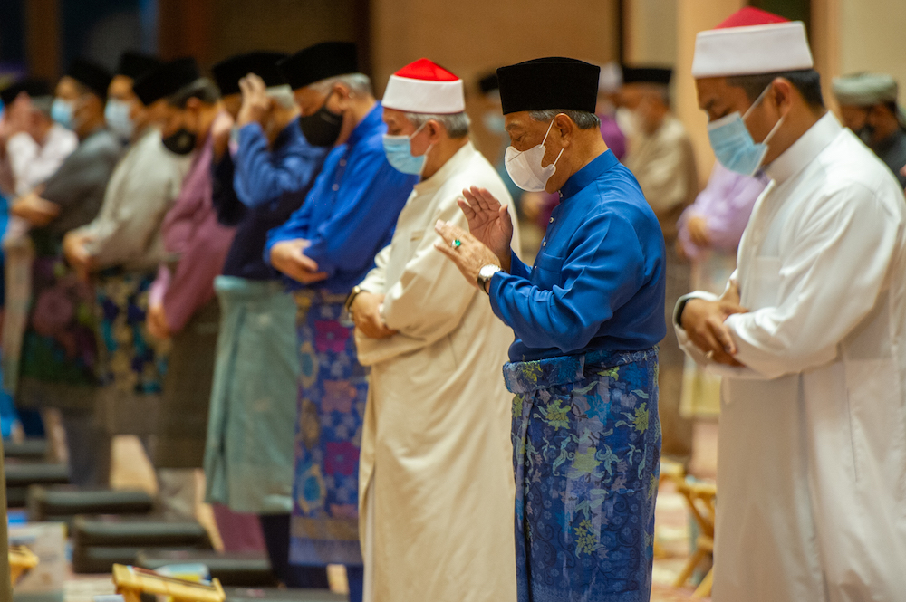 PM Tan Sri Muhyiddin Yassin is seen at special prayers in conjunction with 'Setahun Malaysia Prihatin' at Putra Mosque, Putrajaya, February 28, 2021. — Picture by Shafwan Zaidon