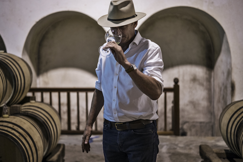 South African wine maker Anthony Hamilton Russell samples a young Chardonnay inside his barrel room at his 52 hectares wine farm in Hemel en Aarde February 23, 2021. — AFP pic