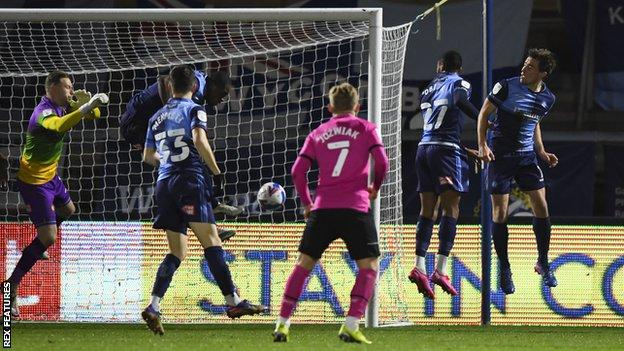 Wycombe's Uche Ikpeazu scores an own goal to put Derby County ahead