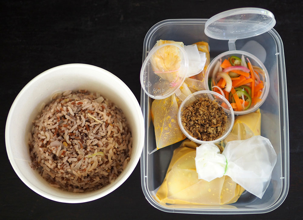 Each element of the 'nasi dagang' is packed separately so just assemble it for your lunch.