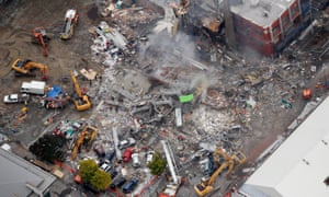 An aerial view of emergency services people working at the ruined CTV building in central in Christchurch