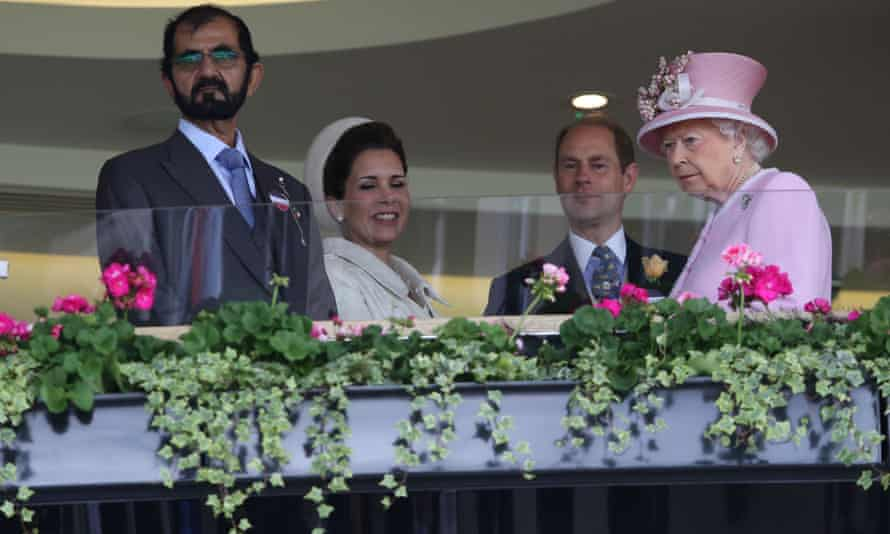 Queen Elizabeth II, Prince Edward, Earl of Wessex, (2R) greet Emir of Dubai Sheikh Mohammed bin Rashid al-Maktoum (L) and his wife Jordan's Princess Haya bint al-Hussein on the second day of the Royal Ascot horse racing meet in Ascot, 2016