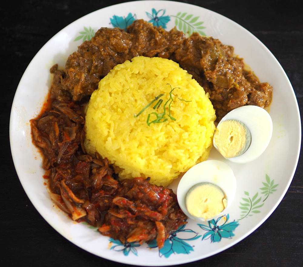 Celebrate with this golden 'pulut kuning' served with 'rendang', 'sambal tumis' and hard boiled egg.
