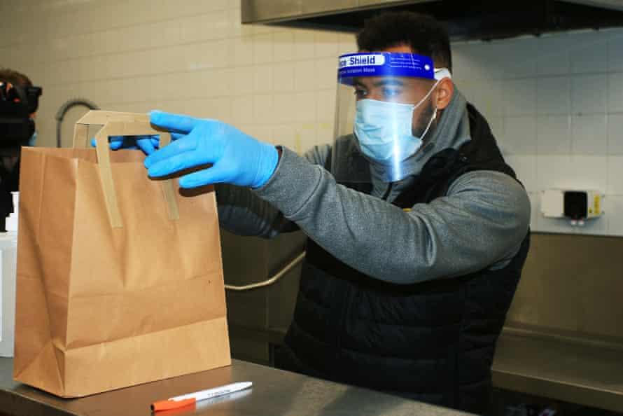 Kane Hemmings prepares a free lunch in the kitchen at the Burton's Pirelli Stadium.