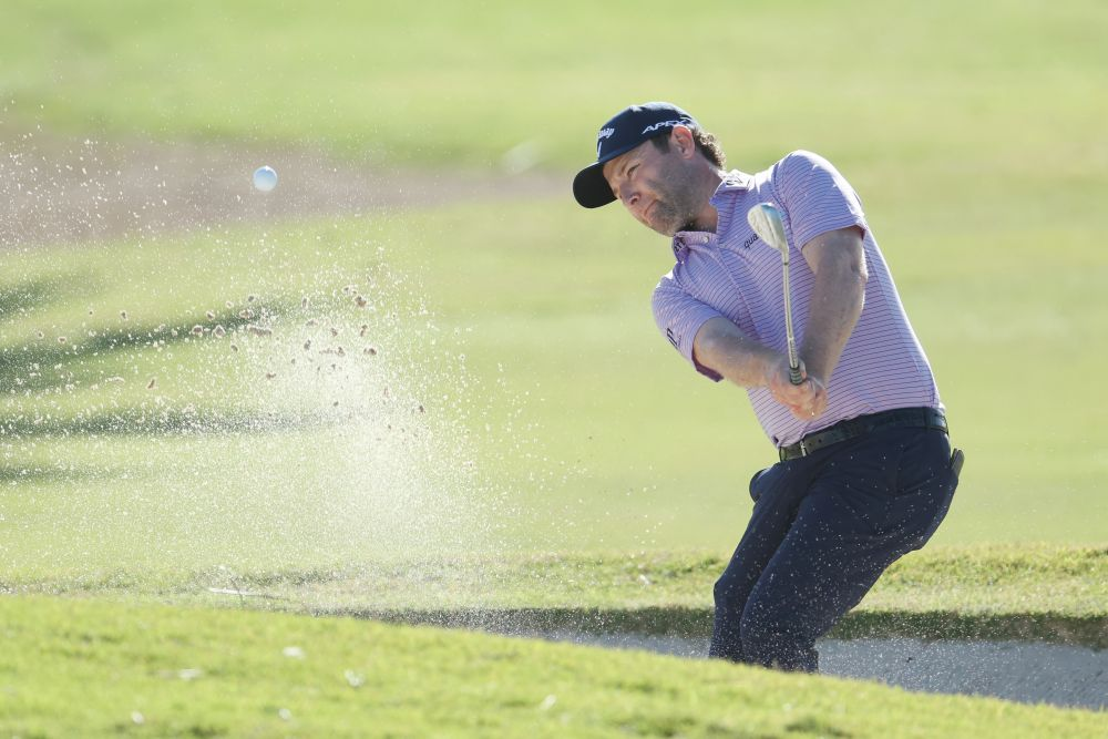 Branden Grace of South Africa plays his third shot on the 15th hole during the final round of the Puerto Rico Open at the Grand Reserve Country Club on February 28, 2021 in Rio Grande. — AFP pic
