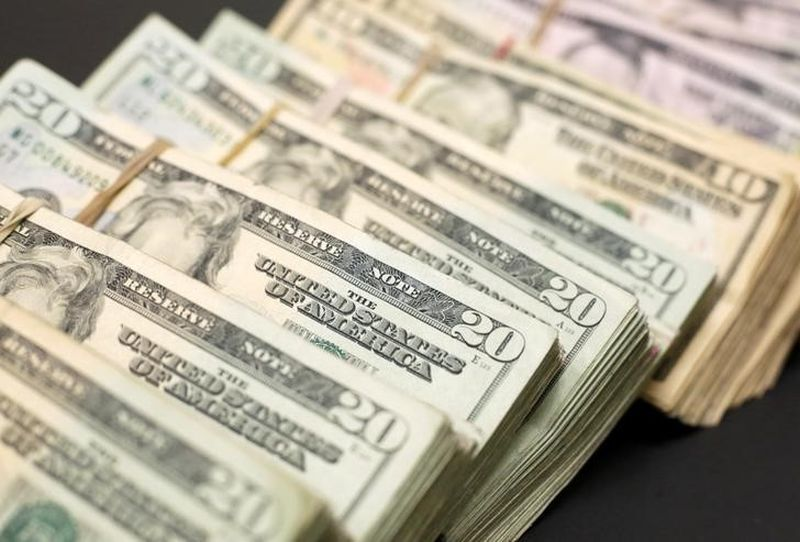 The US dollar was on course to narrowly avoid a fourth straight weekly decline against a basket of major peers today, as analysts said profit-taking on dollar short positions was helping lift the currency. ― Reuters pic