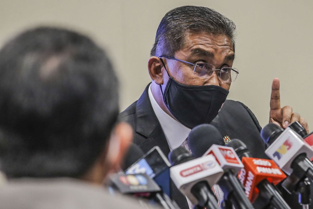 Datuk Seri Takiyuddin Hassan speaks during a press conference on the Emergency Ordinance in Putrajaya March 12, 2021. — Picture by Hari Anggara