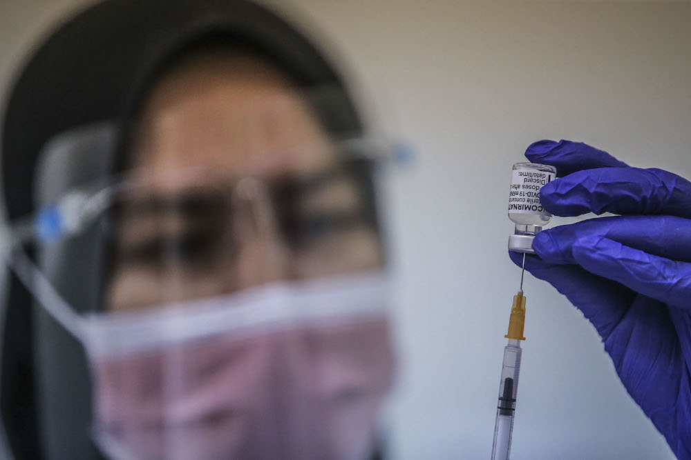 A health worker loads a syringe with a dose of the Pfizer-BioTech Covid-19 vaccine at the UiTM Hospital in Sungai Buloh March 2, 2021. ― Picture by Hari Anggara