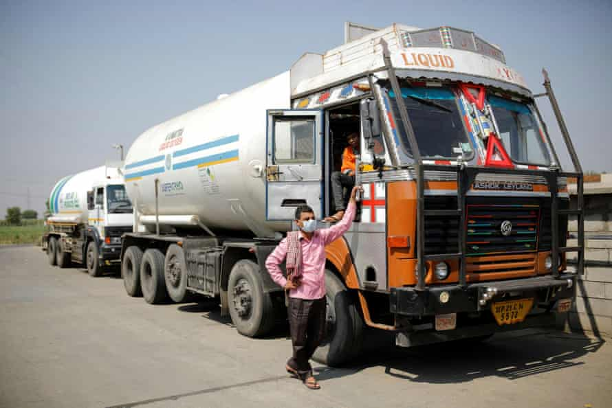 A driver stands next to an empty tanker as he waits for his turn to fill liquid oxygen, to be transported to a COVID-19 hospital on the outskirts of New Delhi, India, April 22