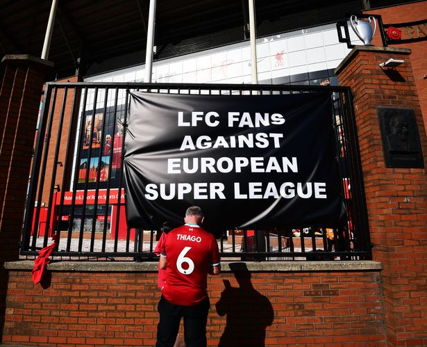 Liverpool fans tied banners to the gates at The Kop