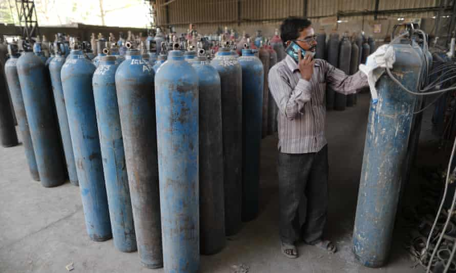 Medical oxygen cylinders being refilled at a charging station in Uttar Pradesh state.