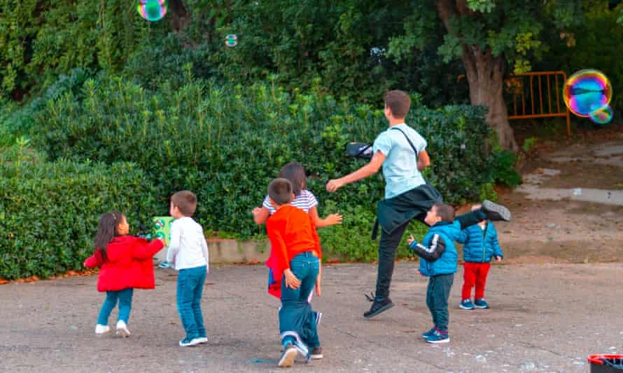 Children play with bubbles in Barcelona, Spain.