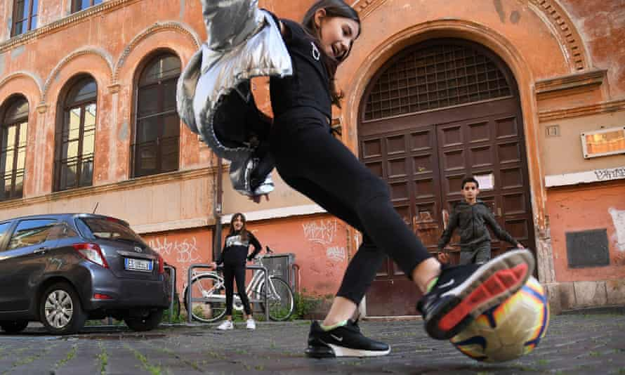 Children playing football in Rome
