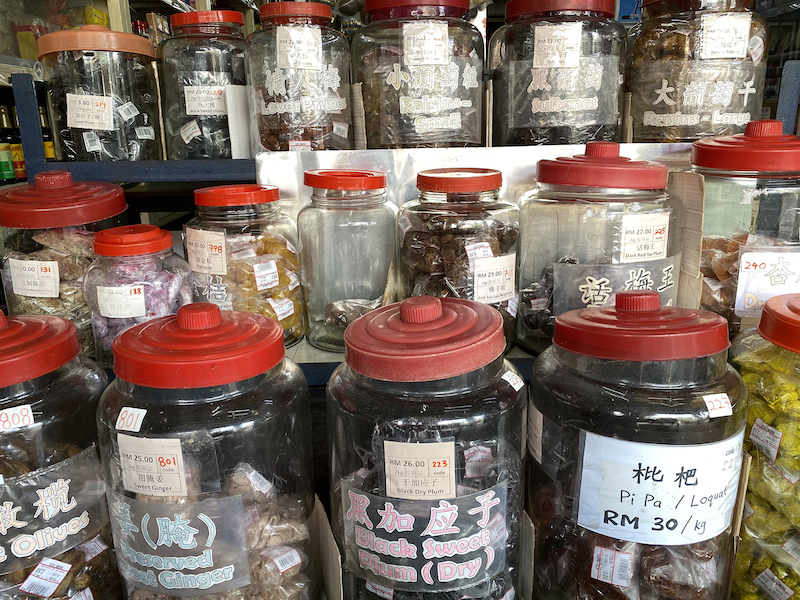Various types of food items are kept in the old large glass jars. — Picture by KE Ooi