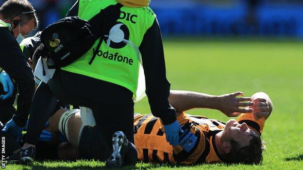 Joe Launchbury lies injured