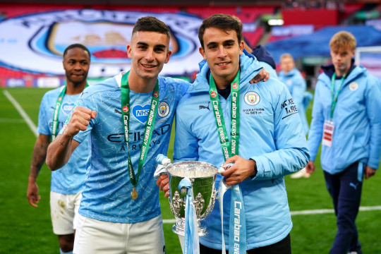 Manchester City stars Ferran Torres and Eric Garcia celebrate with the Carabao Cup
