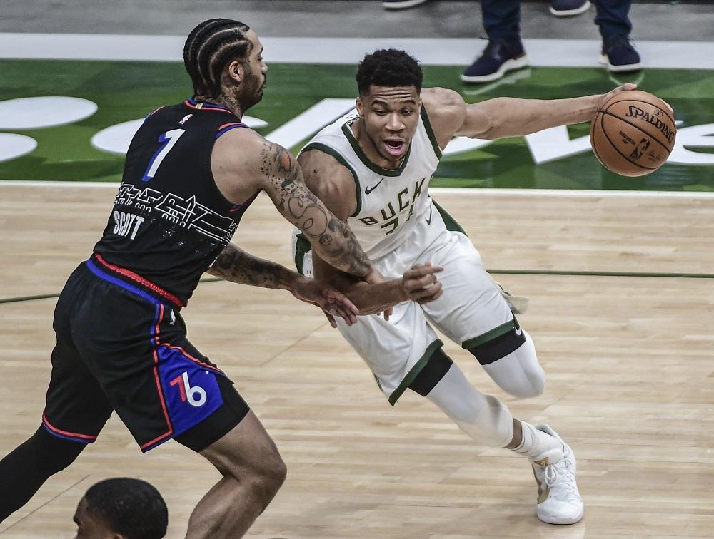 Milwaukee Bucks forward Giannis Antetokounmpo (34) drives to the basket against Philadelphia 76ers forward Mike Scott (1) in the first quarter at Fiserv Forum. ― Benny Sieu-USA TODAY Sports pic via Reuters