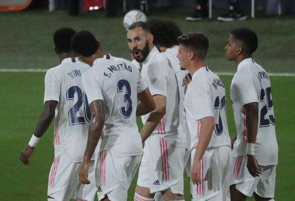 Real Madrid's Karim Benzema celebrates scoring their first goal against Cadiz with teammates at  Estadio Ramon de Carranza, Cadiz April 21, 2021. — Reuters pic