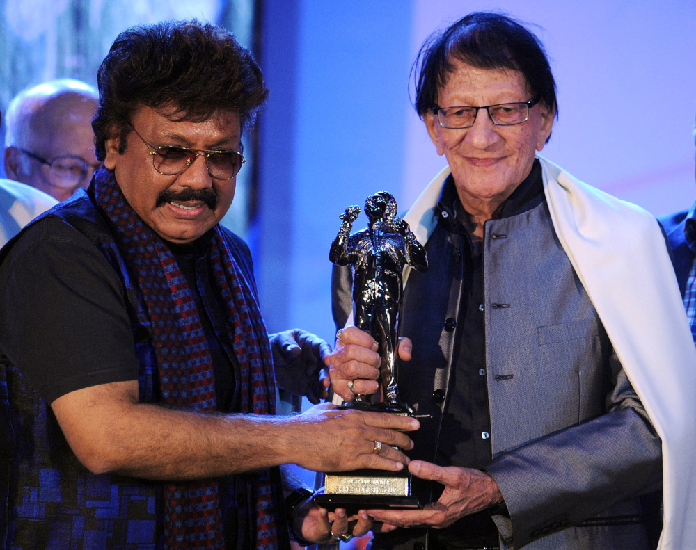 In this file photo taken February 29, 2016 Bollywood music director/composer Shravan Rathod (left) and writer/lyricist Yogesh Gaur pose for a photograph during the Ravindra Jain Academy Awards ceremony in Mumbai. — AFP pic