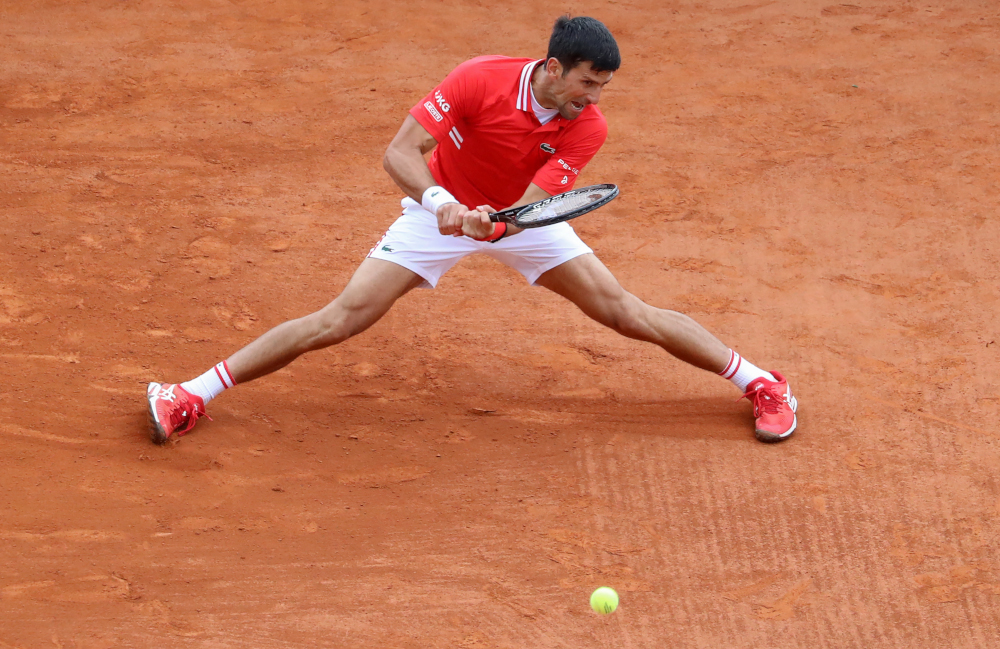 Serbia's Novak Djokovic plays a return during his second round singles match against Italy's Jannik Sinner on day five of the Monte-Carlo ATP Masters Series tournament in Monaco April 14, 2021. — AFP pic