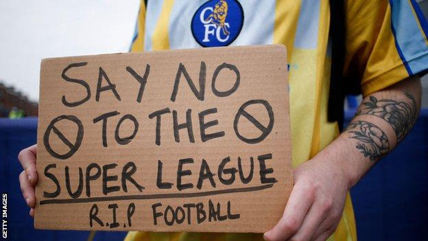 A Chelsea fan protests outside Stamford Bridge