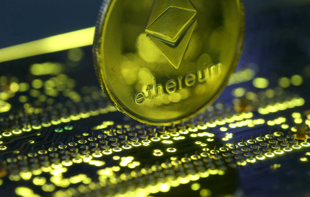 Representation of the Ethereum virtual currency standing on the PC motherboard is seen in this illustration picture, February 3, 2018. — Reuters pic