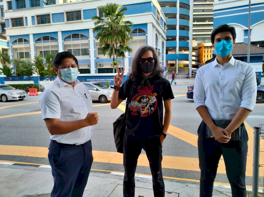 Fahmi Reza is shown here outside the Dang Wangi district police station after his release from his overnight arrest and one-day remand. His lawyers Yohendra Nadarajan (left) and Rajsurian Pillai were also present. April 24, 2021. — Picture courtesy of Rajsurian Pillai