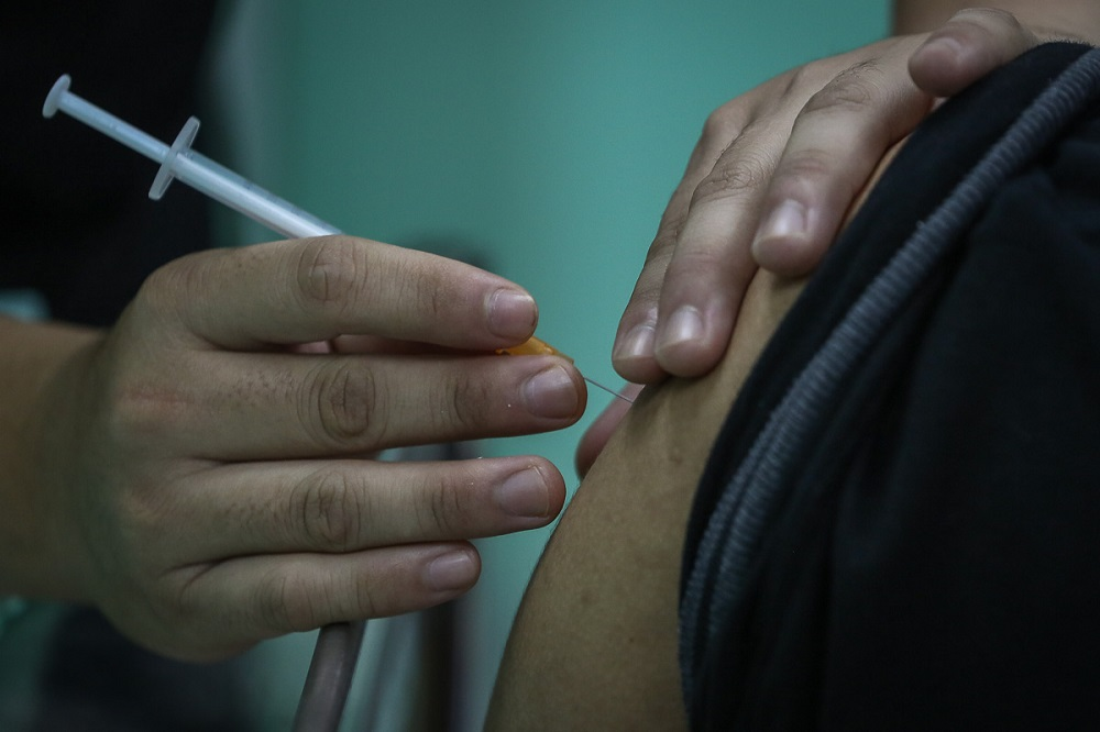 A health worker receives the Pfizer-BioNTech Covid-19 vaccine at the Klinik Kesihatan in Kelana Jaya March 6, 2021. ― Picture by Yusof Mat Isa