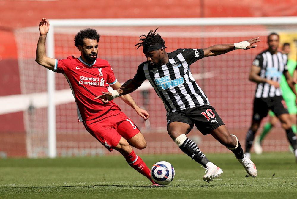 Newcastle United's Allan Saint-Maximin in action with Liverpool's Mohamed Salah during their Premier League match at Anfield, Liverpool, April 24, 2021. — Pool picture via Reuters