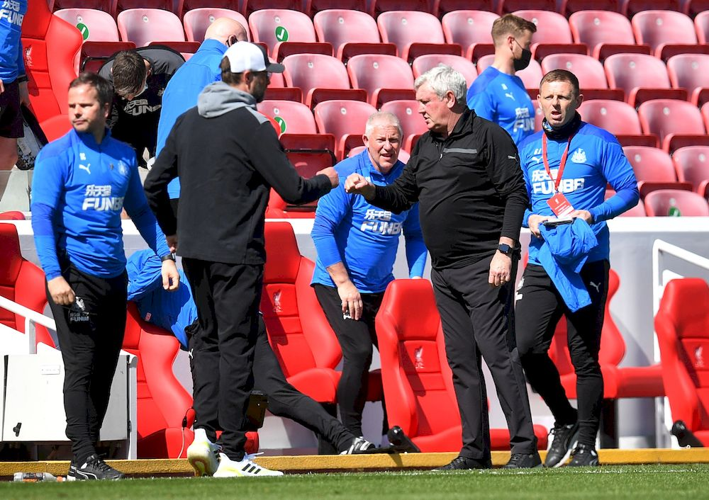 Newcastle United manager Steve Bruce bumps fists with Liverpool manager Juergen Klopp at the end of their Premier League match at Anfield, Liverpool, April 24, 2021. — Pool picture via Reuters