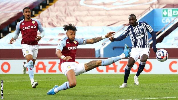 West Brom score a second goal against Aston Villa as Mbaye Diagne's shot is deflected into the net via a deflection off Tyrone Mings