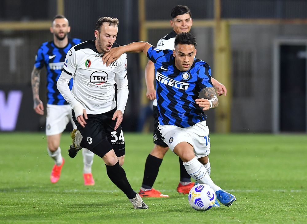 Inter Milan's Lautaro Martinez in action with Spezia's Ardian Ismajli at Stadio Dino Manuzzi, La Spezia April 21, 2021. — Reuters pic