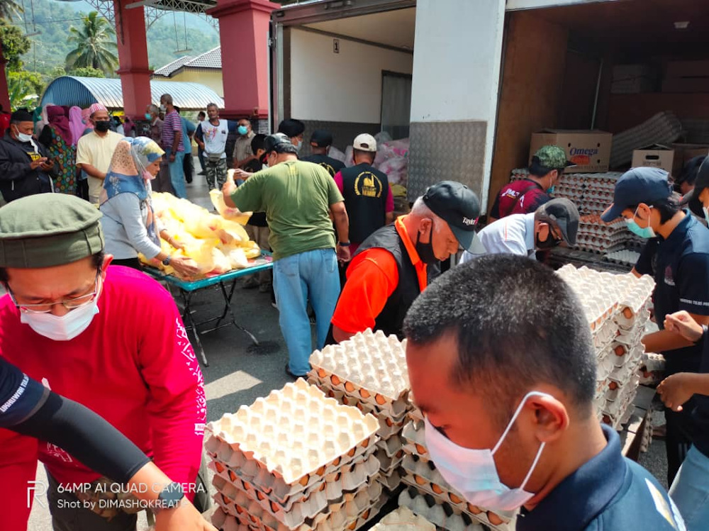 Masjid Abdul Rahman 'Auf distributed 15,000 chicken eggs, 500 frozen chickens and bags of rice for the hardcore poor at Larut, Matang and Selama district on April 11. — Picture courtesy of Masjid Abdul Rahman 'Auf