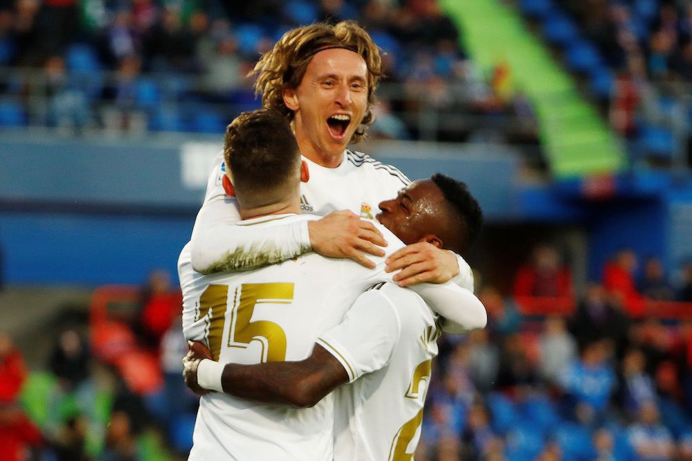 Real Madrid's Luka Modric celebrates scoring their third goal with Federico Valverde and Vinicius Junior during the La Liga match with Getafe at Coliseum Alfonso Perez in Getafe January 4, 2020. — Reuters pic